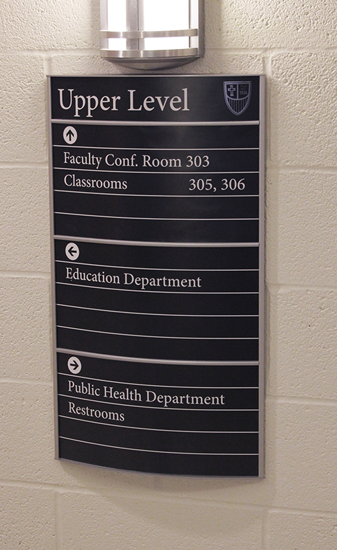 college interior building directional sign