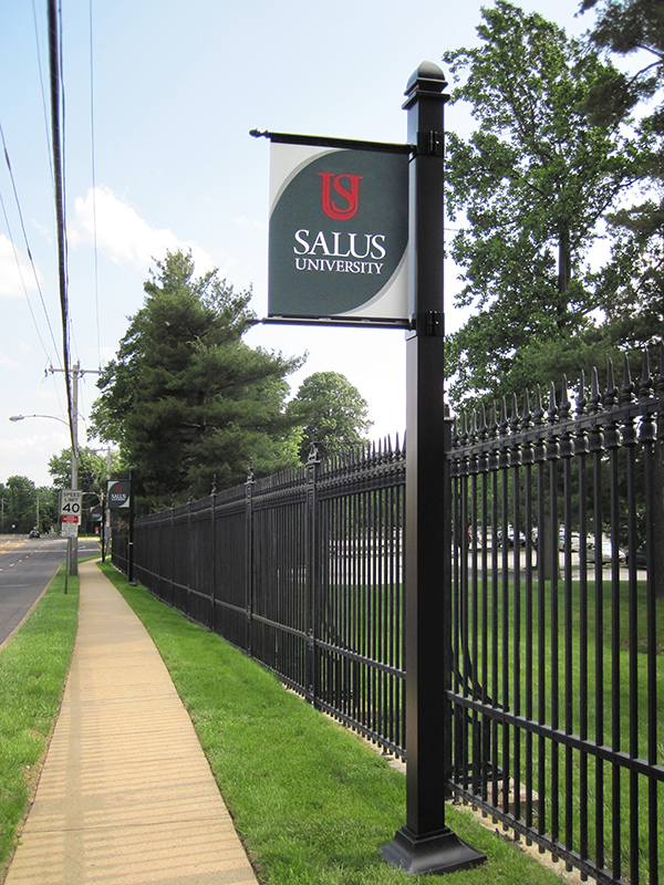 exterior campus branding shield sign